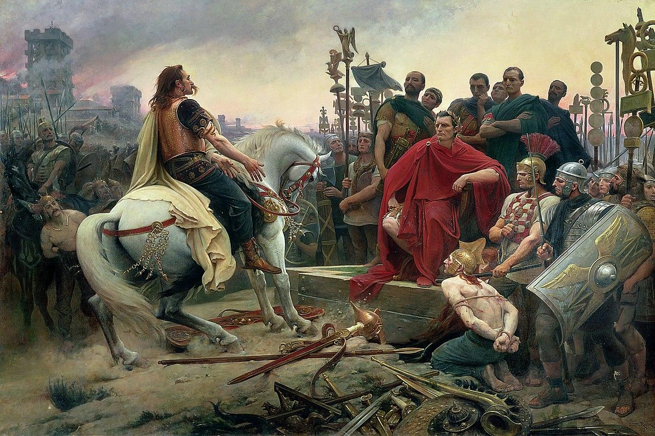 『カエサルの足元に武器を投げ捨ててみせるウェルキンゲトリクス』リオネル・ロワイエ(1899年)